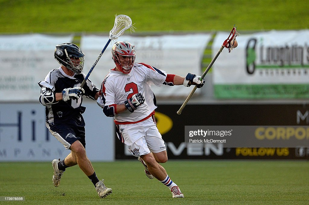 Scott Ratliff #2 of Boston Cannons battles for the ball against Ben Rubeor #6 of Chesapeake Bayhawks during a game at Navy-Marine Corps Memorial Stadium on July 18, 2013 in Annapolis, Maryland.