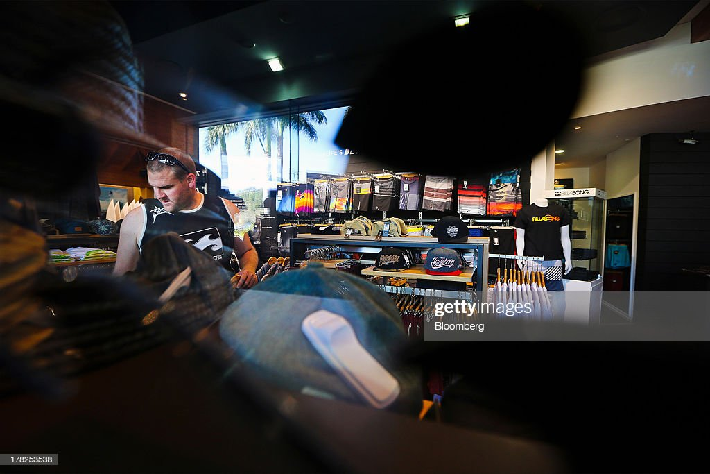 Scott Ravel browses merchandise inside a Billabong International Ltd. retail store at the company's headquarters in Burleigh Heads, Australia, on Wednesday, Aug. 28, 2013. Billabong, the surf brand founded in 1973, helped sell Australian surfing culture worldwide and rose to a market value of A$3.84 billion ($3.45 billion) at its peak in 2007 said its 40-year-old surf brand was worthless after the companys losses tripled amid store closures, firings and a breach of debt terms. Photographer: Patrick Hamilton/Bloomberg via Getty Images
