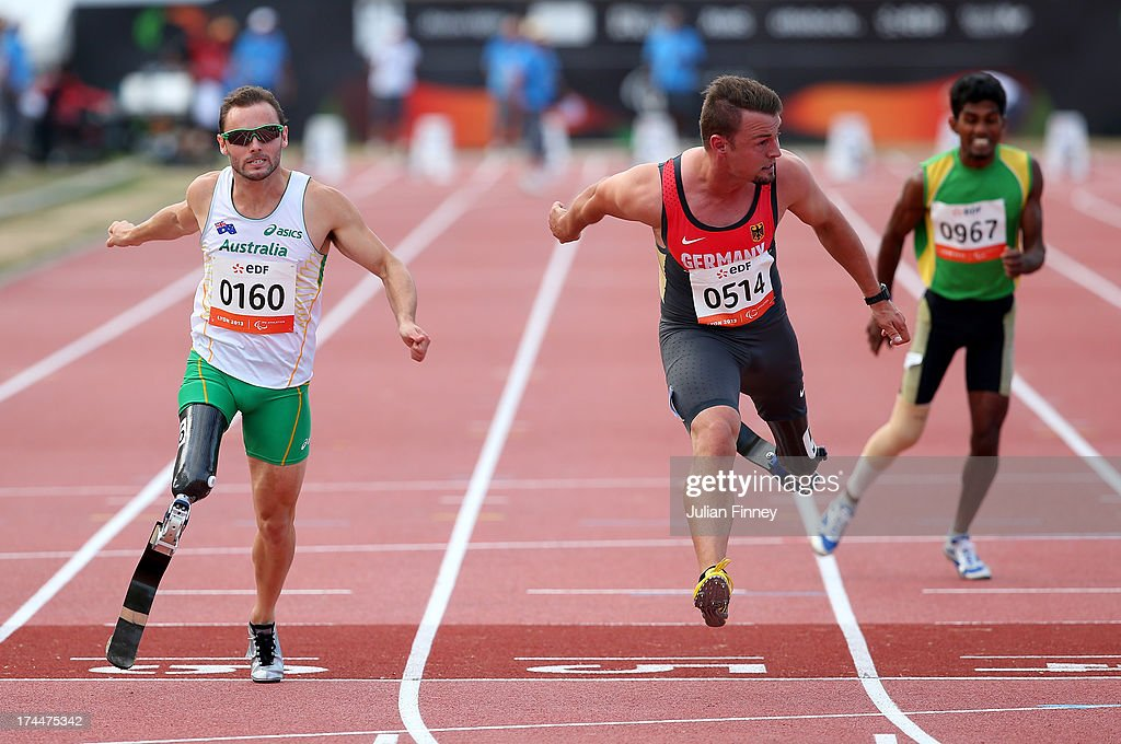 Scott Readon of Australia (L) and Heinrich Popow of Germany cross the line together in the Men's 100m T42 final during day seven of the IPC Athletics World Championships on July 26, 2013 in Lyon, France.
