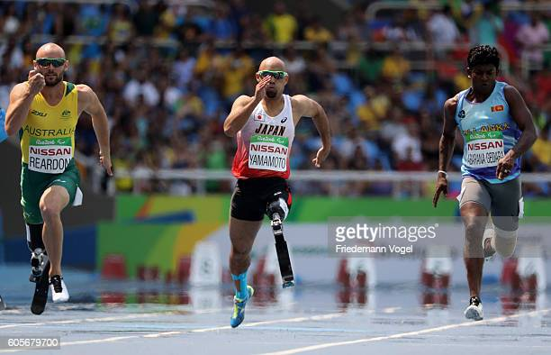 Scott Reardon of Australia Atsushi Yamamoto of Japan and Upul Indika Chulada Abarana Gedara of Sri Lanka compete in the Men's 100m T42 Heat 2 on day...
