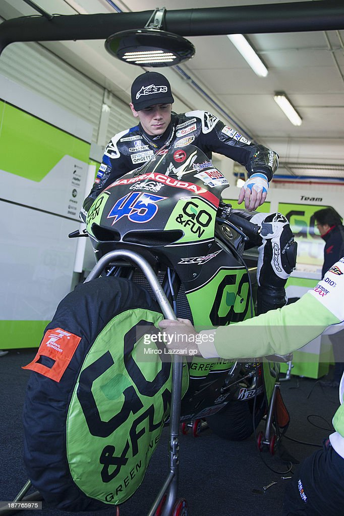 Scott Redding of Great Britain and Go&Fun Honda Gresini test the bike in box during the MotoGP Tests in Valencia - Day 2 at Ricardo Tormo Circuit on November 12, 2013 in Valencia, Spain.
