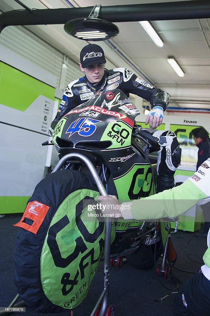 Scott Redding of Great Britain and Go&Fun Honda Gresini test the bike in box during the MotoGP Tests in Valencia - Day 2 at Ricardo Tormo Circuit on November 12, 2013 in Valencia, Spain.