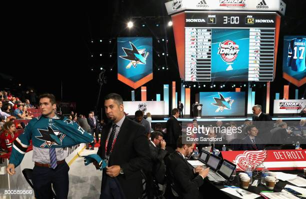 Scott Reedy puts on his jersey after being selected 102nd overall by the San Jose Sharks during the 2017 NHL Draft at United Center on June 24 2017...
