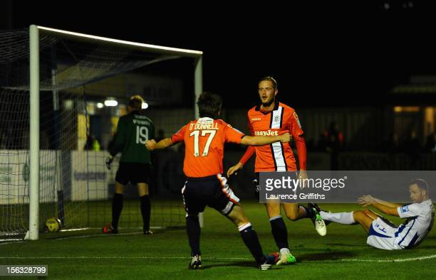 Scott Rendell of Luton Town celebrates his goal with JJ O'Donnell during the FA Cup First Round Replay match between Nuneaton Town and Luton Town at...