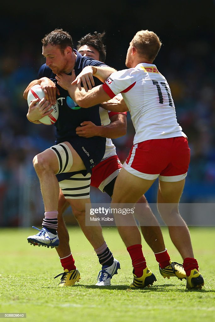 Scott Riddell of Scotland is tackled during the 2016 Sydney Sevens bowl semi final match between Scotland and Canada at Allianz Stadium on February 7, 2016 in Sydney, Australia.