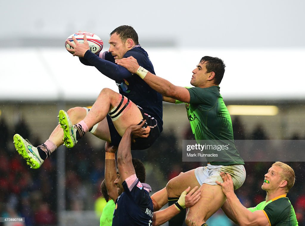 Scott Riddell of Scotland take the ball in the air from a line out under pressure from <a gi-track='captionPersonalityLinkClicked' href=/galleries/search?phrase=Chris+Dry&family=editorial&specificpeople=6474921 ng-click='$event.stopPropagation()'>Chris Dry</a> of South Africa during the Emirates Airlines Rugby 7s Plate Final match between Scotland and South Africa at Scotstoun Stadium on May 10, 2015 in Glasgow, Scotland.
