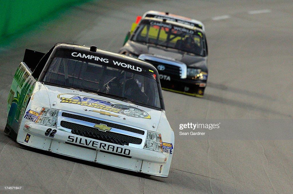 Scott Riggs driver of the Blacks Tire/Fleet HQ/QMI/Davis Tire Chevrolet drives during the NASCAR Camping World Truck Series UNOH 225 at Kentucky...