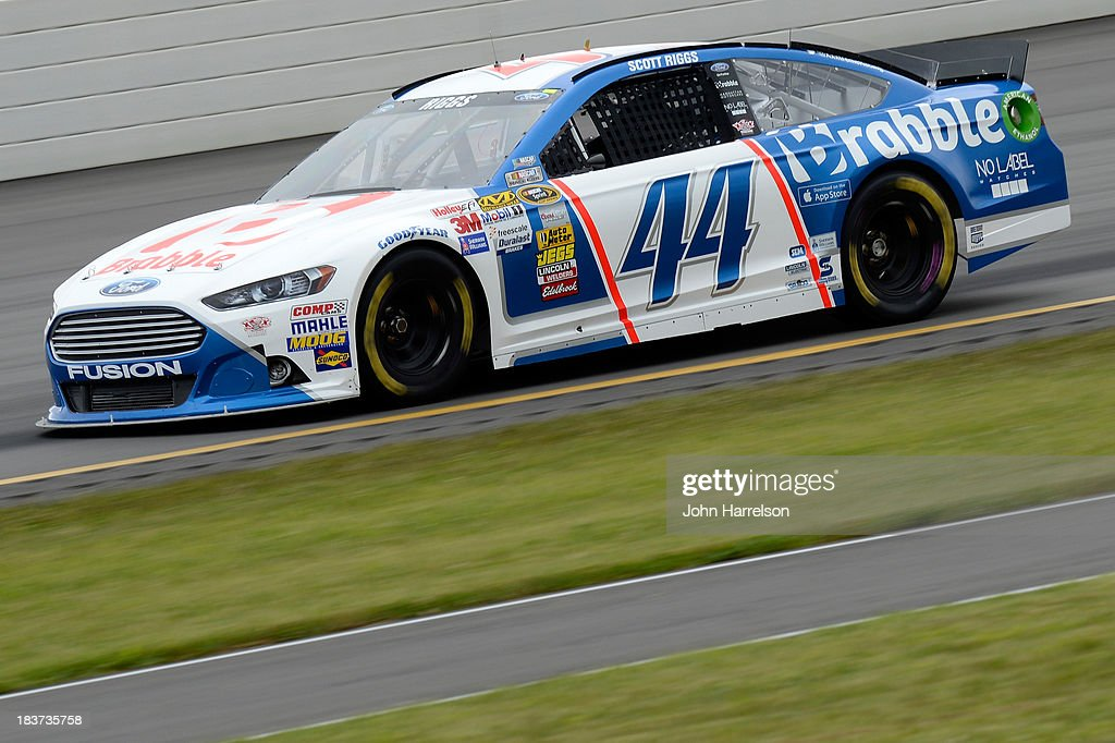 Scott Riggs driver of the Brabble Ford during practice for the NASCAR Sprint Cup Series Party in the Poconos 400 at Pocono Raceway on June 8 2013 in...