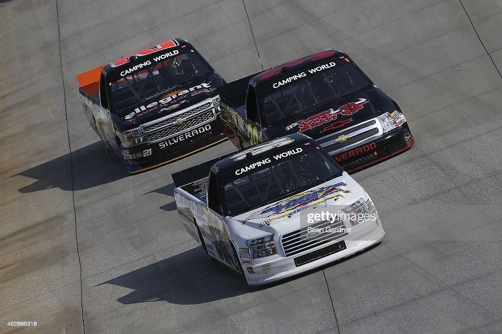 Scott Riggs driver of the BTS Tire/ Goodyear Fleet HQ/ Wynns Ford leads a pack of trucks during the NASCAR Camping World Truck Series Lucas Oil 200...
