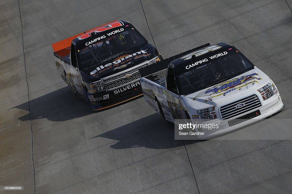 Scott Riggs driver of the BTS Tire/ Goodyear Fleet HQ/ Wynns Ford races with Joey Coulter driver of the Allegiant Chevrolet during the NASCAR Camping...