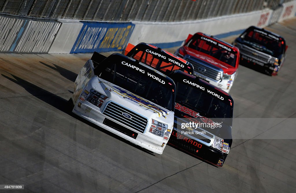 Scott Riggs driver of the BTS Tire/Goodyear Fleet HQ/Wynns Ford leads a pack of trucks during the NASCAR Camping World Truck Series Lucas Oil 200 at...