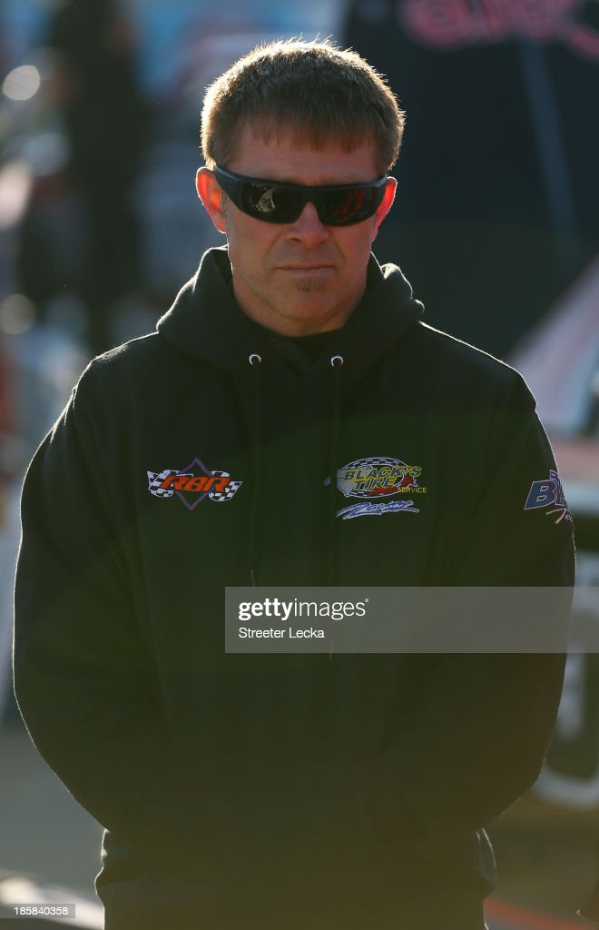 Scott Riggs driver of the Carquest WorldPac/Goodyear Fleet Headquarters/QMI Chevrolet stands on the grid during practice for the NASCAR Camping World...