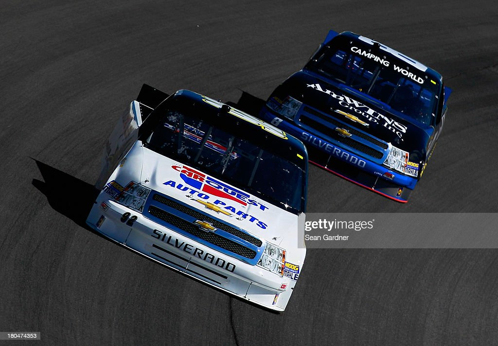 Scott Riggs driver of the CarQuest WorldPac/GoodyearFleetHQ Chevrolet and Ron Hornaday Jr driver of the Anderson's Maple Syrup / JewelOsco Chevrolet...
