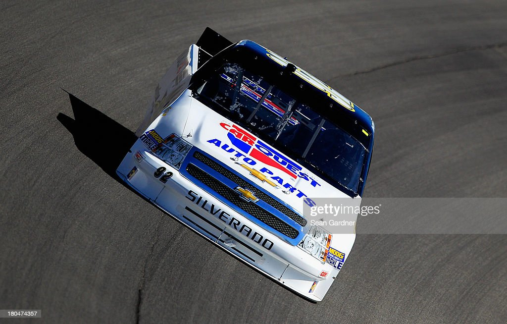 Scott Riggs driver of the CarQuest WorldPac/GoodyearFleetHQ Chevrolet practices for the NASCAR Camping World Truck Series enjoyillinoiscom 225 at...