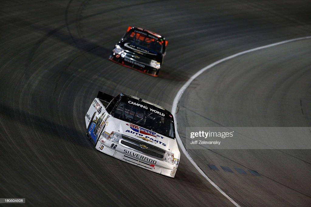 Scott Riggs driver of the CarQuest WorldPac/GoodyearFleetHQ Chevrolet races during the NASCAR Camping World Truck Series enjoyillinoiscom 225 at...