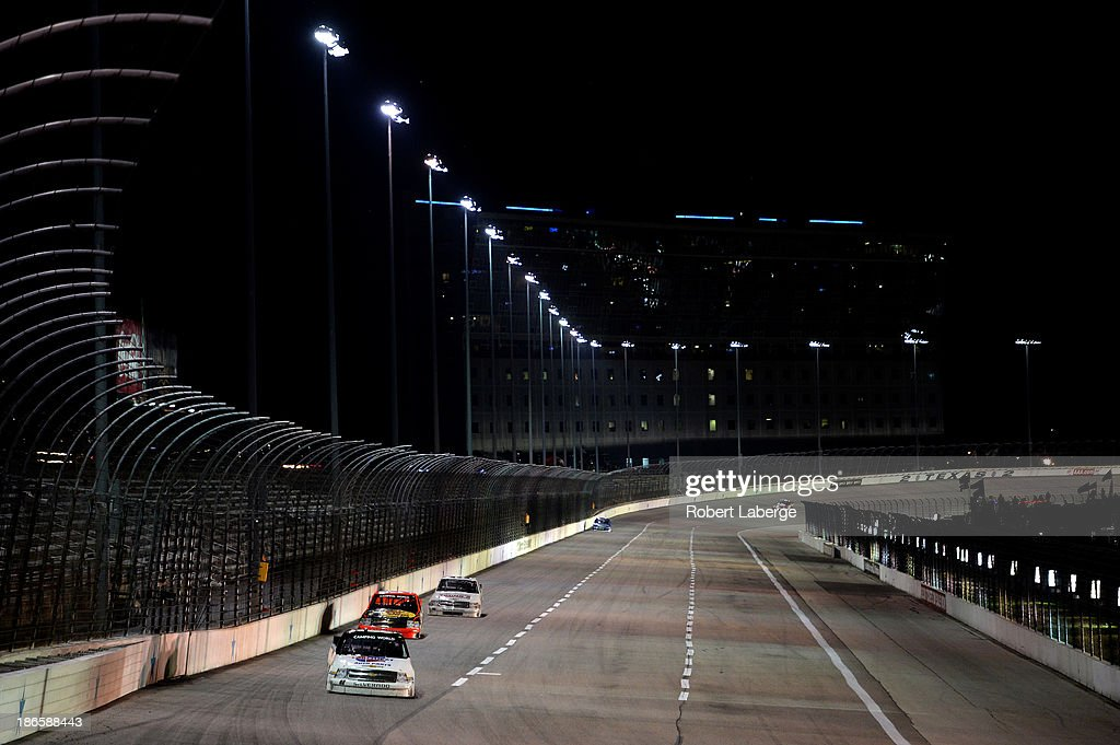 Scott Riggs driver of the Carquest/WorldPac/Goodyear Flee HQ/QMI Chevrolet leads a pack of trucks during the NASCAR Camping World Truck Series...