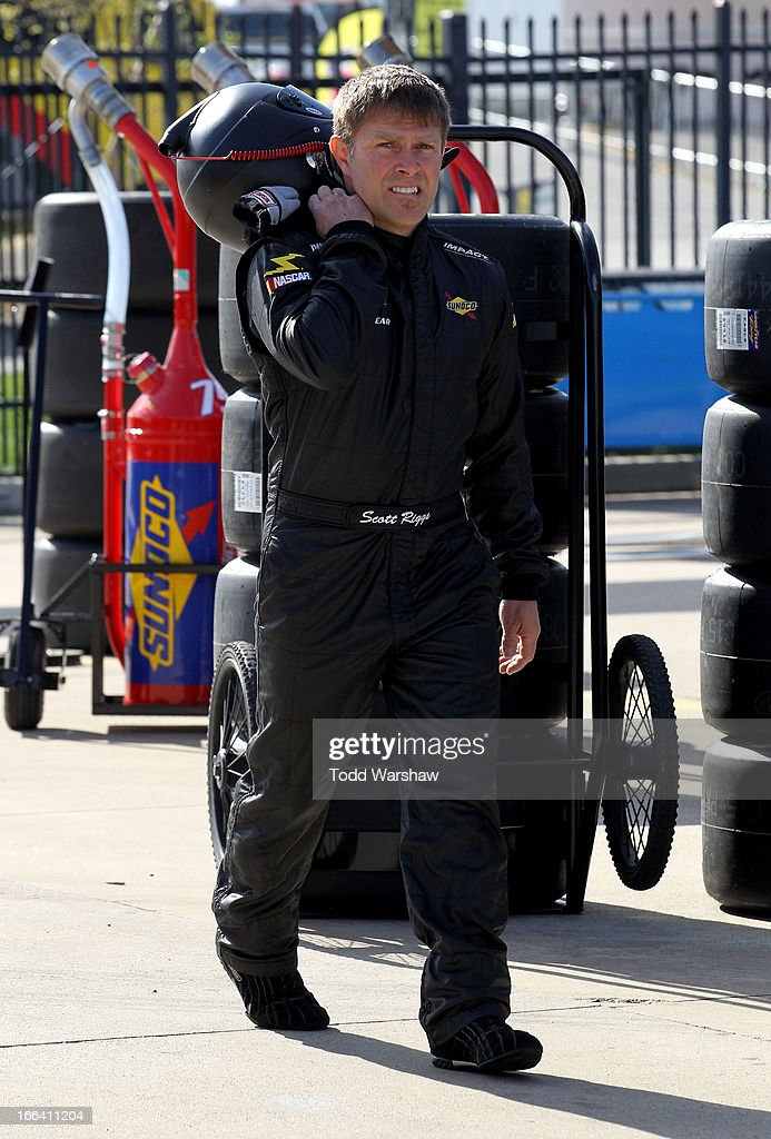 Scott Riggs driver of the Curtis Key Plumbing Chevrolet stands in the garage area during practice for the NASCAR Nationwide Series O'Reilly Auto...