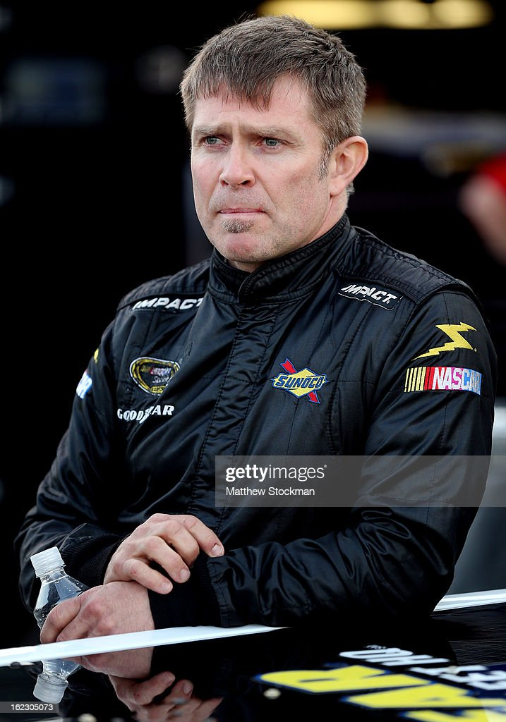 Scott Riggs driver of the FleetHQcom/BTS Tire Wheel Chevrolet looks on before practice for the NASCAR Camping World Truck Series Next Era Energy...