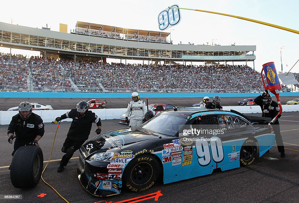 Scott Riggs driver of the KeyedUp Motorsports Chevrolet pits during the NASCAR Sprint Cup Series SUBWAY Fresh Fit 600 at Phoenix International...