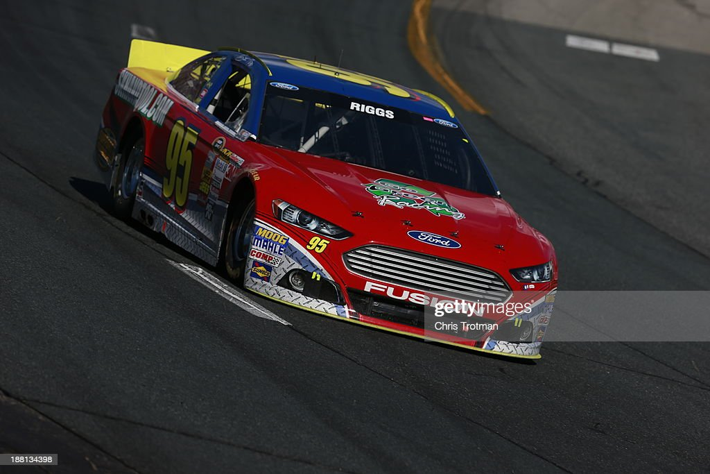 Scott Riggs driver of the Leavine Family Racing Ford during the NASCAR Sprint Cup Series Sylvania 300 at New Hampshire Motor Speedway on September 22...