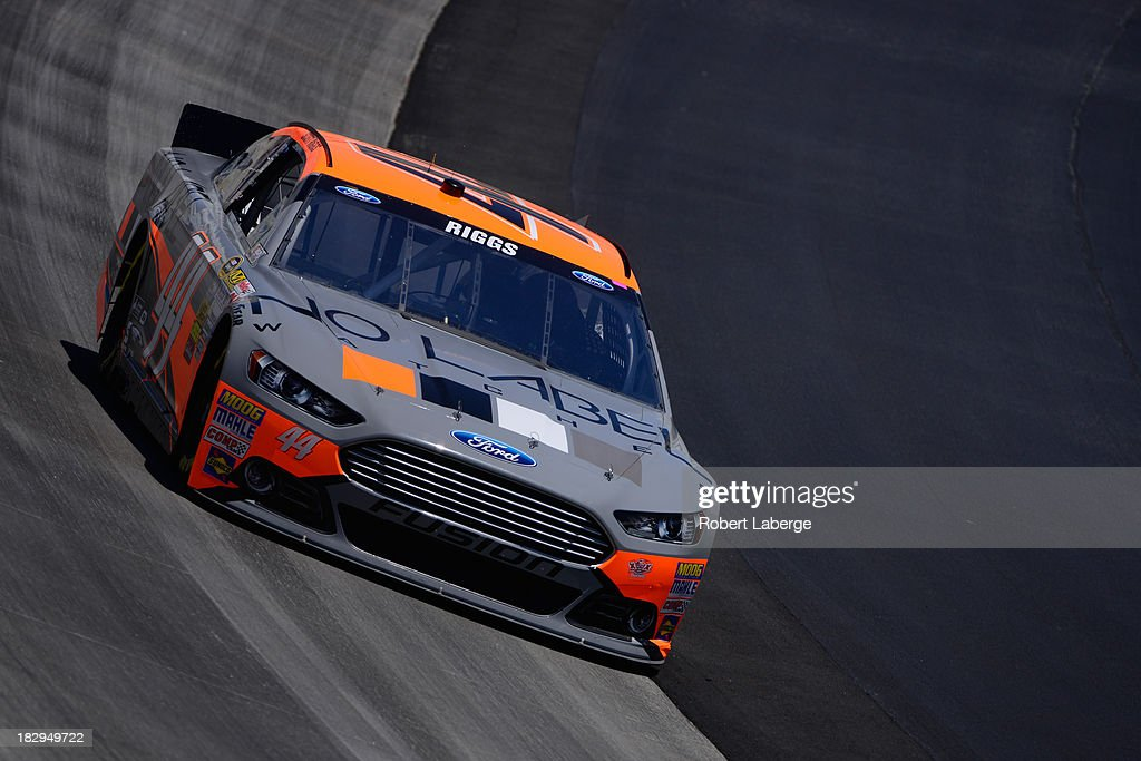 Scott Riggs driver of the No Label Ford during practice for the NASCAR Sprint Cup Series FedEx 400 benefiting Autism Speaks at Dover International...