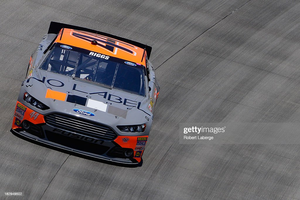 Scott Riggs driver of the No Label Ford practices for the NASCAR Sprint Cup Series FedEx 400 benefiting Autism Speaks at Dover International Speedway...