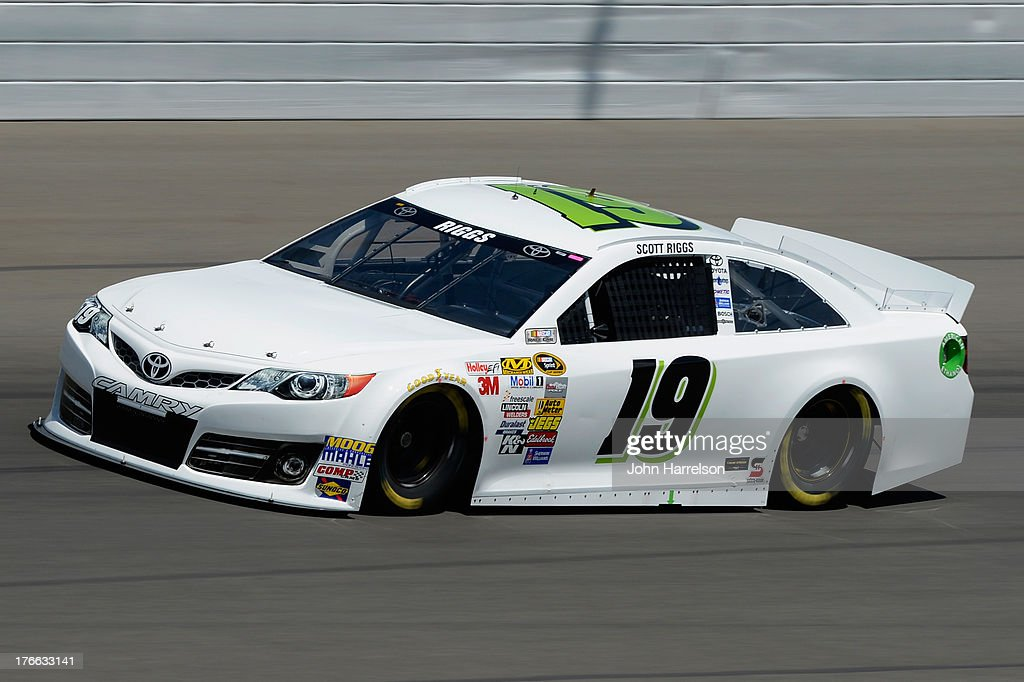 Scott Riggs driver of the Plinker Tactical Toyota practices for the NASCAR Sprint Cup Series 44th Annual Pure Michigan 400 at Michigan International...