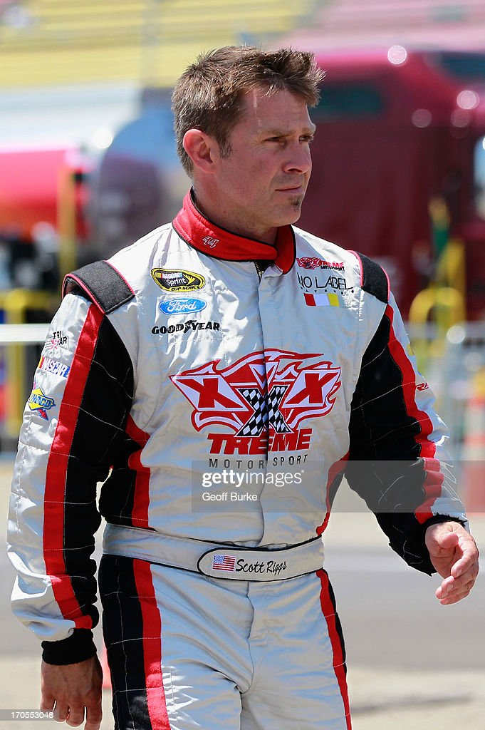 Scott Riggs driver of the Takagi Tankless Water Heaters Toyota walks through the garage during practice for the NASCAR Nationwide Series Alliance...