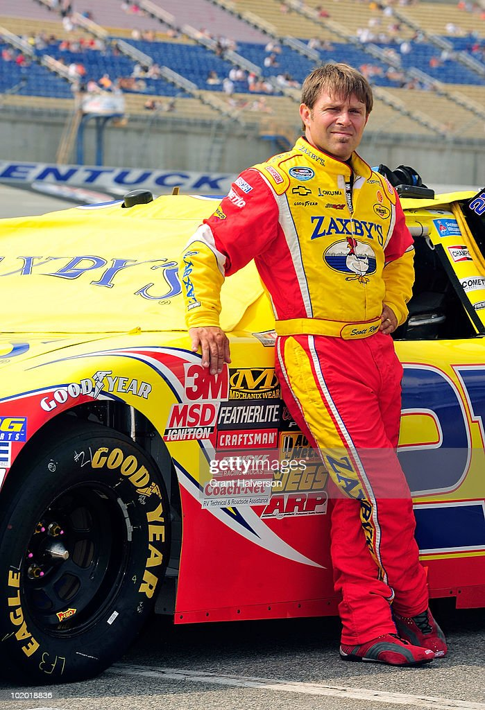 Scott Riggs driver of the Zaxby's Chevrolet waits to qualify during the NASCAR Nationwide Series Meijer 300 presented by Ritz at Kentucky Speedway on...