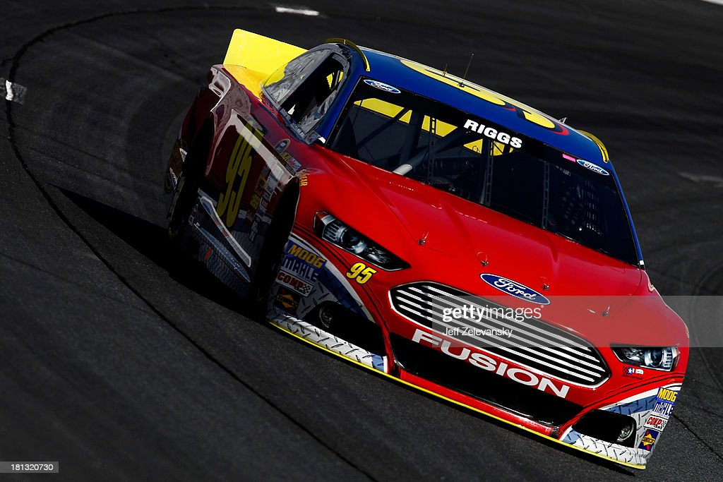 Scott Riggs drives the Leavine Family Racing Ford during practice for the NASCAR Sprint Cup Series Sylvania 300 at New Hampshire Motor Speedway on...