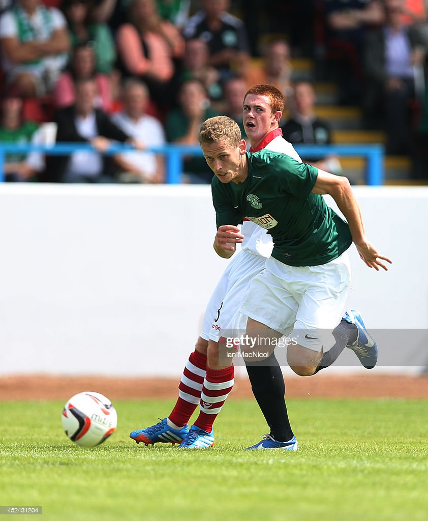 Scott Robertson of Hibernian chases the ball during the Pre Season Friendly match between Stirling Albion and Hibernian at Forthbank Stadium on July 20, 2014 in Stirling, Scotland.