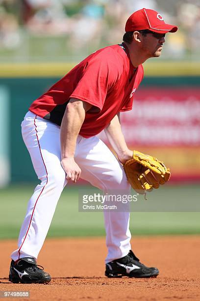Scott Rolen of the Cincinnati Reds fields at third base against the Cleveland Indians during a spring training game at Goodyear Ballpark on March 5...