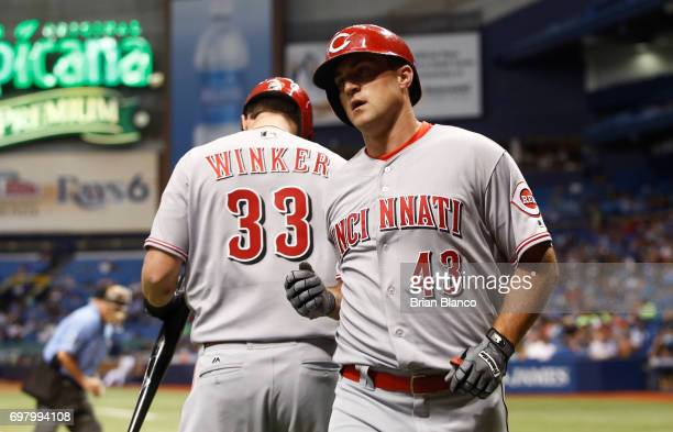 Scott Schebler of the Cincinnati Reds celebrates with teammate Jesse Winker after hitting a home run off of pitcher Jake Odorizzi of the Tampa Bay...
