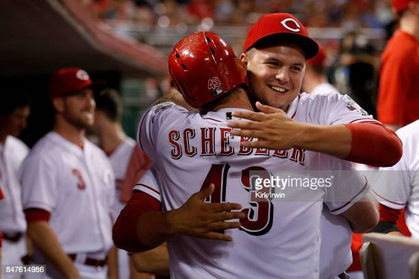 Scott Schebler of the Cincinnati Reds is congratulated by Sal Romano of the Cincinnati Reds after hitting a home run during the fifth inning of the...