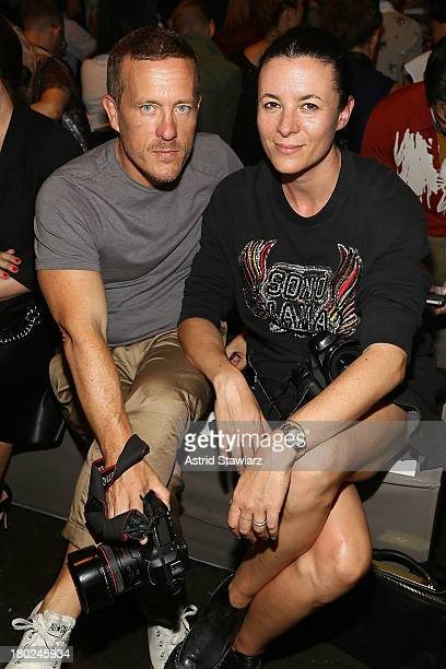 Scott Schuman and Garance Dore attend the Marc By Marc Jacobs fashion show during MercedesBenz Fashion Week Spring 2014 at Pier 57 on September 10...