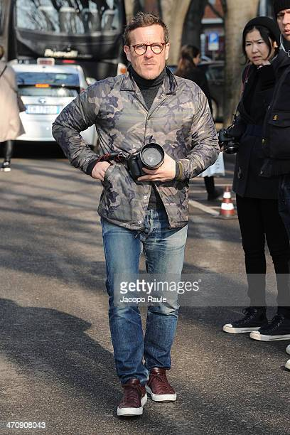 Scott Schuman arrives at Emporio Armani Fashion Show during Milan Fashion Week Womenswear Autumn/Winter 2014 on February 21 2014 in Milan Italy