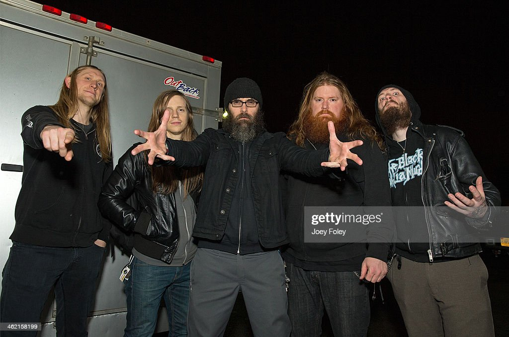 Scott 'Scunty D.' Hedrick, Evan 'Loosh' Linger, Chance Garnette, Nate 'N8 Feet Under' Garnette, and Dustin Boltjes of Skeletonwitch pose for a photo outside after the concert at The Rock House on January 11, 2014 in Indianapolis, Indiana.