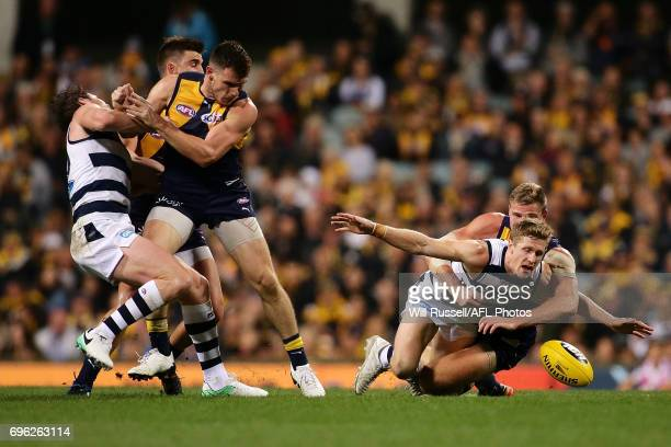 Scott Selwood of the Cats is tackled by Nathan Vardy of the Eagles as Luke Shuey of the Eagles bumps Patrick Dangerfield of the Cats during the round...