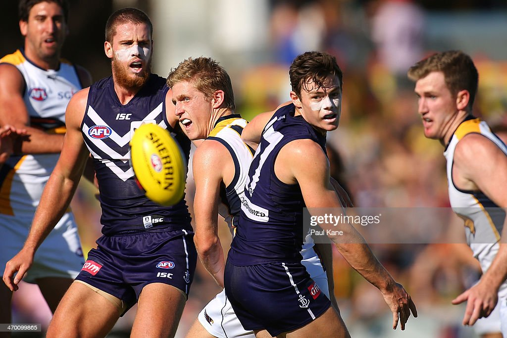 Scott Selwood of the Eagles and Lachie Neale of the Dockers contest for the ball during the round two NAB Challenge Cup AFL match between the Fremantle Dockers and the West Coast Eagles at Arena Joondalup on February 18, 2014 in Perth, Australia.