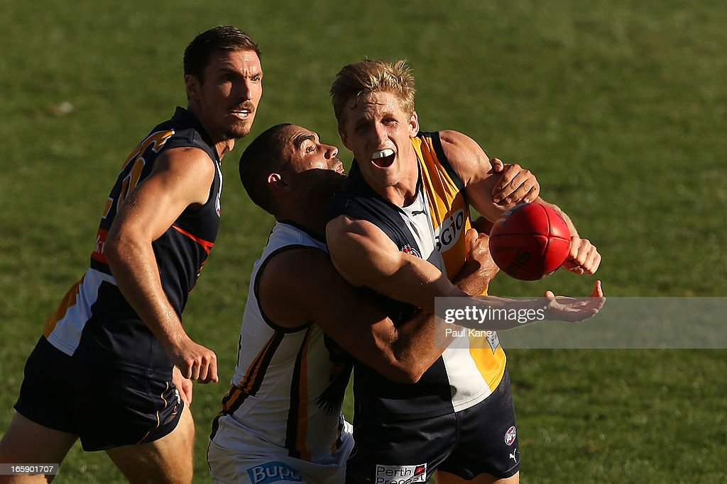 Scott Selwood of the Eagles gets tackled by <a gi-track='captionPersonalityLinkClicked' href=/galleries/search?phrase=Shaun+Burgoyne&family=editorial&specificpeople=224566 ng-click='$event.stopPropagation()'>Shaun Burgoyne</a> of the Hawks during the round two AFL match between the West Coast Eagles and the Hawthorn Hawks at Patersons Stadium on April 7, 2013 in Perth, Australia.