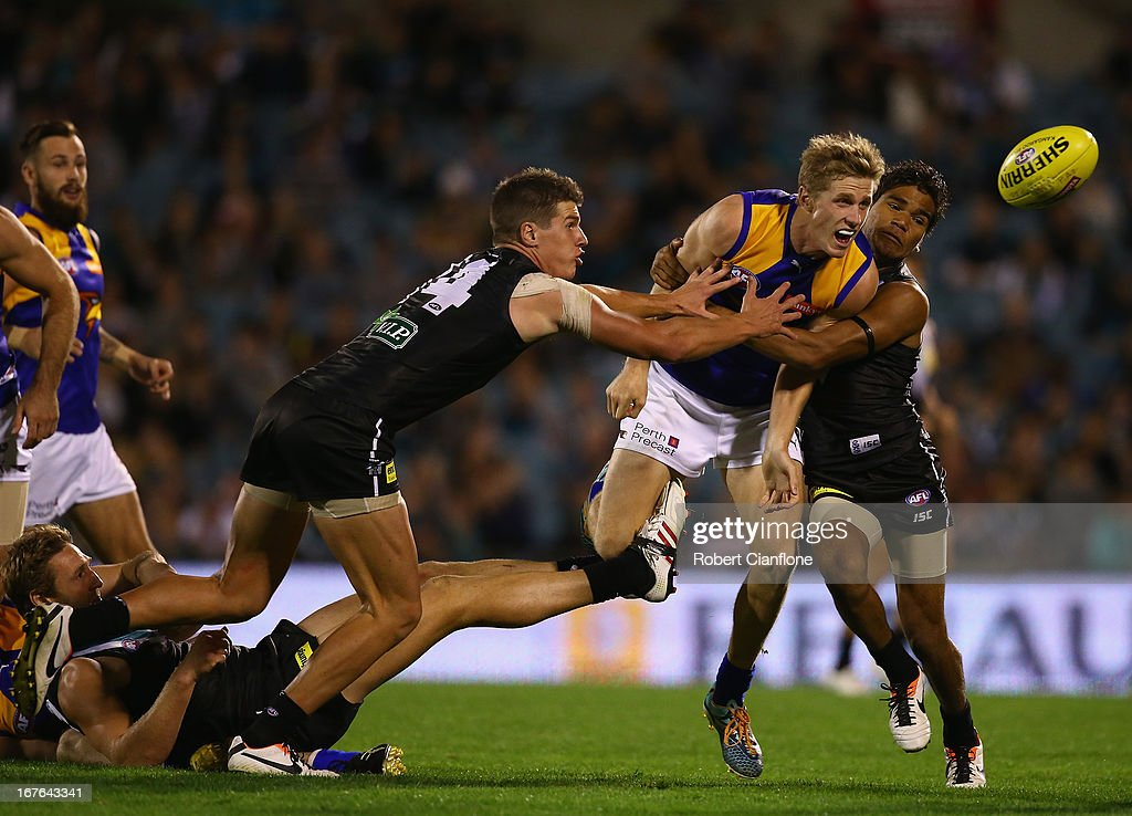 Scott Selwood of the Eagles handballs during the round five AFL match between Port Adelaide Power and the West Coast Eagles at AAMI Stadium on April 27, 2013 in Adelaide, Australia.
