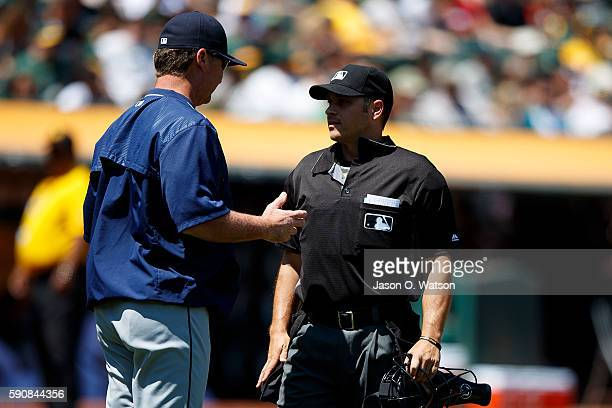 Scott Servais of the Seattle Mariners argues a call with umpire Mark Wegner during the third inning against the Oakland Athletics at the Oakland...