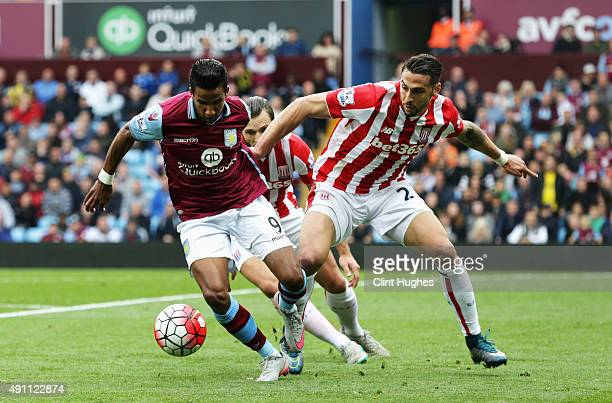 Scott Sinclair of Aston Villa and Geoff Cameron of Stoke City compete for the ball during the Barclays Premier League match between Aston Villa and...