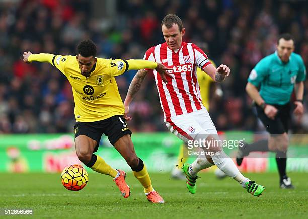 Scott Sinclair of Aston Villa and Glenn Whelan of Stoke City compete for the ball during the Barclays Premier League match between Stoke City and...