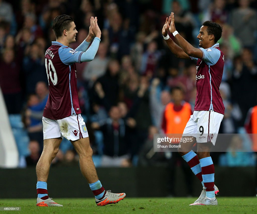 Scott Sinclair (R) of Aston Villa celebrates scoring his hat trick with Jack Grealish during the Capital One Cup second round match between Aston Villa and Notts County at Villa Park on August 25, 2015 in Birmingham, England.