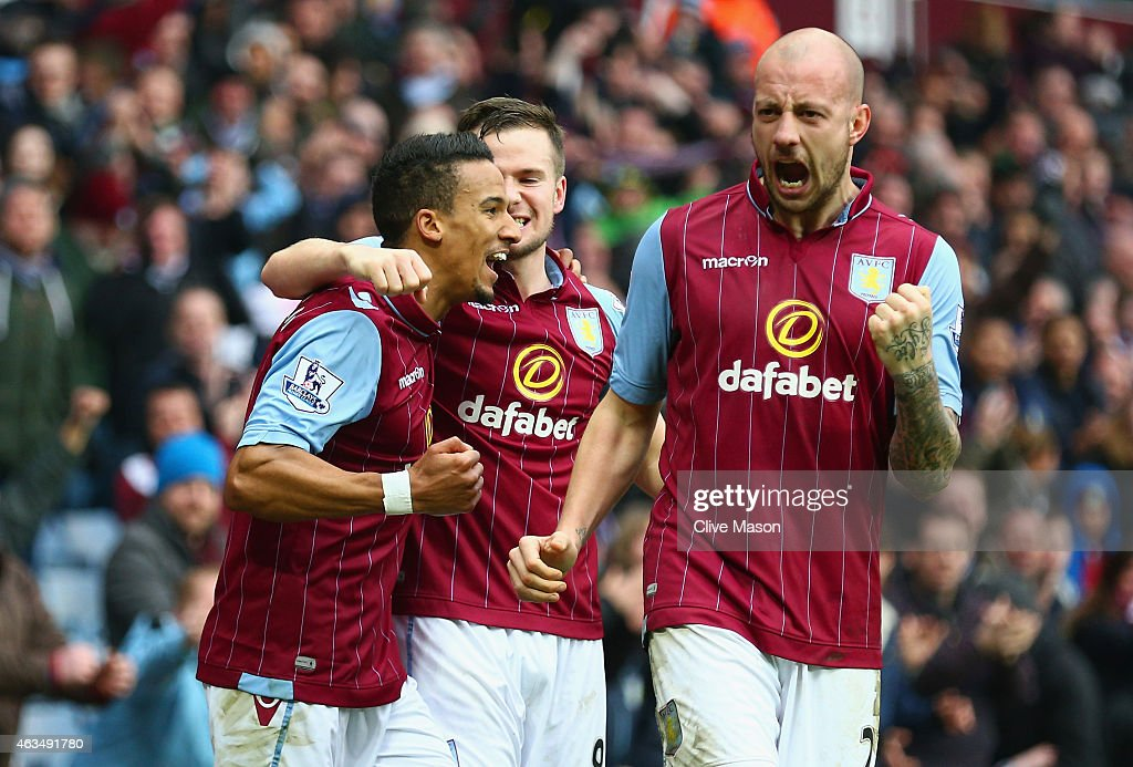 Scott Sinclair of Aston Villa (L) celebrates scoring their second goal with Tom Cleverley and Alan Hutton of Aston Villa during the FA Cup fifth round match between Aston Villa and Leicester City at Villa Park on February 15, 2015 in Birmingham, England.