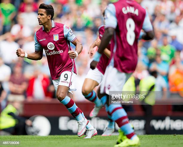 Scott Sinclair of Aston Villa celebrates with his teammates after scoring their first goal during the Barclays Premier League match between Aston...