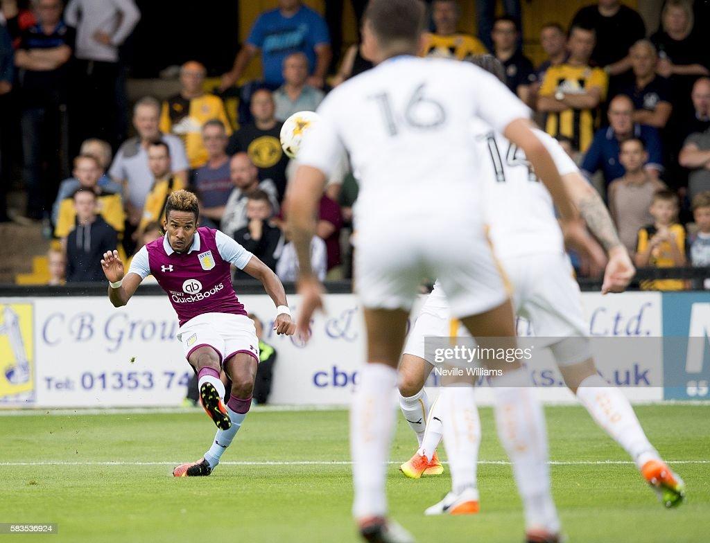 Scott Sinclair of Aston Villa scores for Aston Villa during a Pre Season Friendly match between Cambridge United and Aston Villa at the Abbey Stadium...