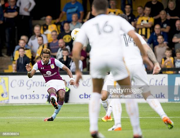 Scott Sinclair of Aston Villa scores for Aston Villa during a Pre Season Friendly match between Cambridge United and Aston Villa at the Abbey Stadium...