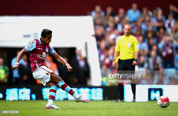Scott Sinclair of Aston Villa scores his team's first goal from the penalty spot during the Barclays Premier League match between Aston Villa and...